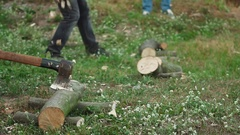 Slow motion of man chopping firewood Stock Footage