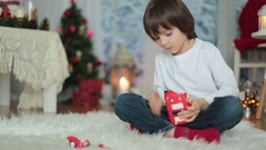 Sweet little boy, breaking his piggy bank to buy present for mom for Christma Stock Footage