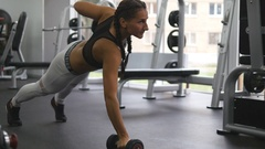 Beautiful female athlete with sexy body training at health club. Close up Stock Footage