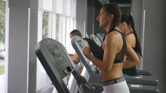 Girl exercising during cardio workout. Female training indoor at sport club Stock Footage