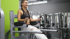 Girl training - lifting legs. Beautiful female torso with piercings at navel Stock Footage