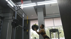 Young strong woman exercising with medicine ball at gym Slow motion Stock Footage