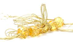 Necklace with cheap plastic gems with golden colored rope Stock Photos