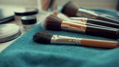 Big brush set for make-up on table Stock Footage