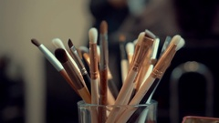 Brush set for make-up on the table, Makeup brush on table Stock Footage