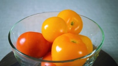 Red and yellow tomatoes spinning plate Stock Footage