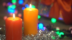 Blowing Christmas Candles on an Abstract Background Bokeh Garlands Stock Footage