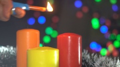 Lighting of The Christmas Candles on a Blurred Background of Abstract Spots Stock Footage