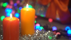 Two Christmas Candles Burn on a Blurred Background Gift Stock Footage