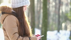 A young girl with long brown hair dials and calls for someone Stock Footage