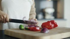 Close-up Shot Showing Delicate Woman Hands Cutting Vegetables on the Kitchen Tab Stock Footage