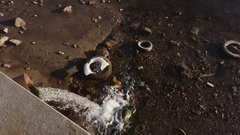 The waste water pipe from the city into the river. Stock Footage