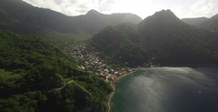 Aerial arriving into the coastal Dominican town of Soufriere Stock Footage