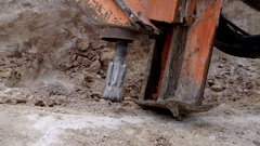 Rock driller start drilling the ground close up slowmo Arkistovideo