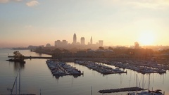 CLEVELAND AERIAL SKYLINE, VIEWED FROM WEST, OVER MARINA THEN LAKE ERIE Stock Footage