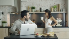 Young Man Shows Something Interesting on a Laptop to His Girlfriend.  Stock Footage
