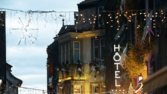 Hotel neon sign and  Christmas Market atmosphere Stock Footage