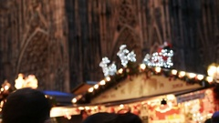 Rear view of couple in love admiring Christmas Market atmosphere and Notre Dame Stock Footage