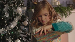 Girl opening boxes with presents Stock Footage