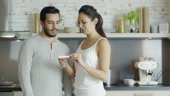 On the Kitchen Beautiful Girl Shows Pregnancy Test Result to Her Boyfriend. Stock Footage