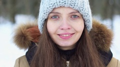 Young, beautiful girl in snowy woods, She is smiling, Slow motion Stock Footage