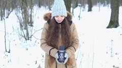 Young girl with long brown hair with retro camera in snowy woods, She is smiling Stock Footage