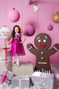 Brunette girl child 5 years old in a pink dress. in holiday rose quartz room Stock Photos