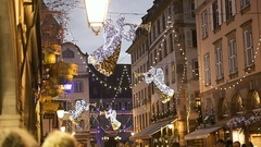 Pedestrians and light angels at Christmas Market Atmosphere people admiring Stock Footage