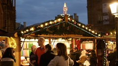 Best Christmas Market Atmosphere people admiring Christmas Chalets Stock Footage