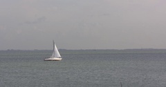 Small sailboat on inland lake IJsselmeer, The Netherlands Stock Footage