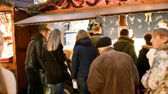 Best Christmas Market Atmosphere people admiring Christmas Chalets slowmotion Stock Footage