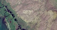 High-altitude overflight aerial of coastal marshland in the Florida everglades. Stock Footage