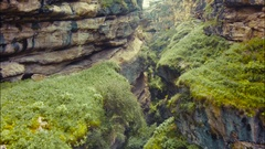 Epic aerial fly down rocky canyon and amazing Avatar style grassy hills in view Stock Footage