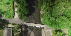 Aerial tracking forwards overhead of the Rosalie river in Dominica Stock Footage
