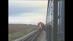 Vintage 16mm film, 1961, back of train POV, train passes, close! Stock Footage