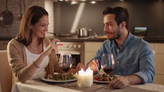 Beautiful Couple Having Candlelight Dinner in the Kitchen. They Eat, Drink. Stock Footage