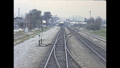 Vintage 16mm film, 1961, back of train POV beyond Colton Tower Stock Footage