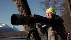 Wildlife Photographer Panning Camera Stock Footage