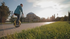 A young man riding a monowheel Stock Footage