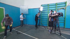 Lighting group is preparing the set for shooting a TV program Stock Footage