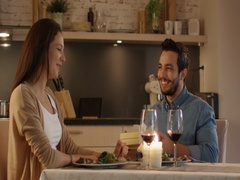 Couple Having Romantic Dinner. Handsome Man Gives His Girlfreind a Gift Box.  Stock Footage