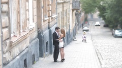 Young couple in love on the streets of the old town Stock Footage