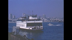 Vintage 16mm film, 1969, San Diego, Silver Strand ferry with city in BG Stock Footage