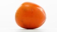 Orange mature kaki   rotates in loop  Stock Footage