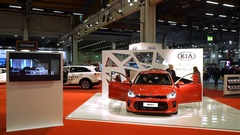 Stand of new models Kia Rio at the auto show. Visitors examine new vehicles. Stock Footage