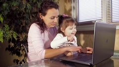 Family working on laptop Stock Footage