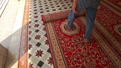 Man Barefoot Rolls out Carpet on Floor of Mosque in Saigon Stock Footage