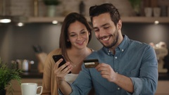 Beautiful Couple Uses Credit Card to Buy Something with Credit Card that Man Hol Stock Footage