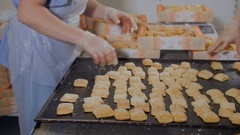 Unrecognizable Pastry Chef packing biscuits, cookies in industrial food factory Stock Footage