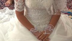 Blond Bride in White under Veil Sits on Carpet in Muslim Mosque Stock Footage